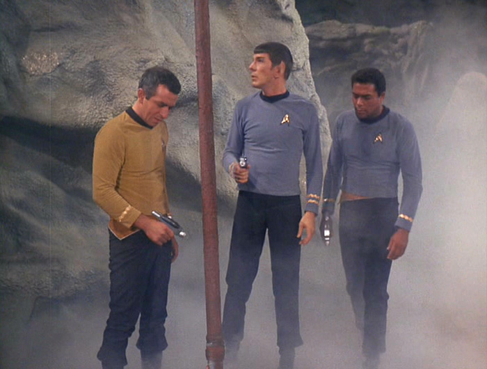 Spock and crew examine the dead and hidden body of Latimer